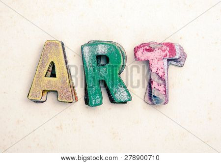 the wor ART  wit old wooden letters on old paper