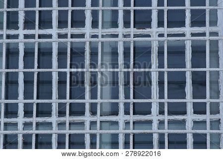 Texture Of White Iron Grill And Gray Glass On The Window