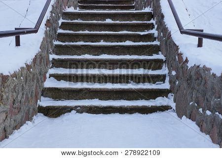 Old Gray Concrete Staircase With Stone Steps Under White Snow Outside