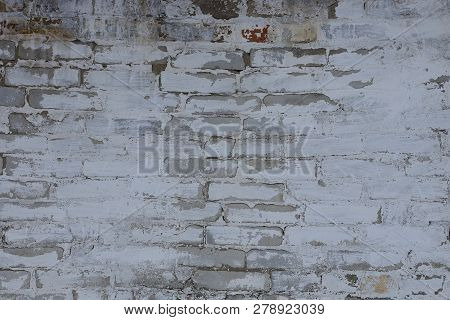 Gray Stone Texture Of Old Bricks And Plaster In The Wall