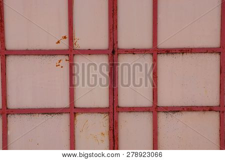 Background Of Metal From Red Iron Rods On A Brown Wall