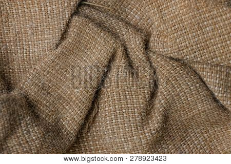 Brown Fabric Texture From Crumpled Piece Of Cloth Burlap