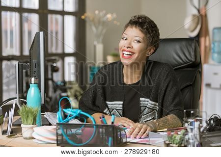 Stylish Laughing Professional Woman In Her Office