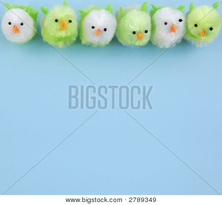 Row Of Easter Chicks On Blue Background
