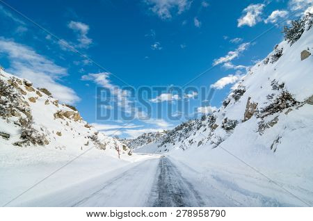 Frozen Road With Snow-covered Hills In Inyo County, California