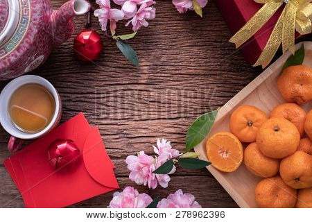 Orange Fruit, Pink Cherry Blossom And Chinese New Year Composition Set On Wood Table, Chinese New Ye