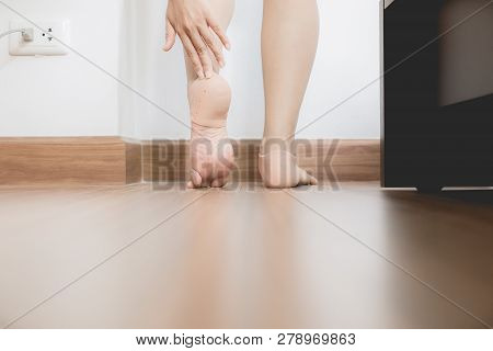 Woman Using Support Silicone For Treatment Plantar Fasciitis On Her Foot