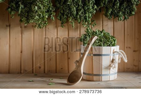 A Wooden Bucket And A Birch Broom In A Russian Bath. Sauna.