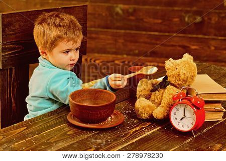 Dinner Time. Little Boy And Teddy Bear Have Dinner Together. Child Feed Toy With Healthy Dinner. Din
