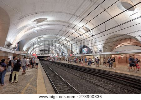 ROME, ITALY - AUGUST 16, 2018: People on the station Termini in Metro of Rome. Opened in 1955, Termini is currently the only station in the Rome Metro system to serve both Lines A and B