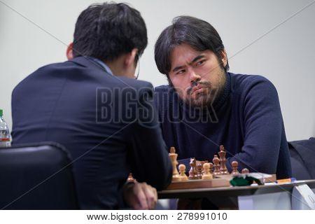 ST. PETERSBURG, RUSSIA - DECEMBER 28, 2018: Grandmaster Hikaru Nakamura, USA competes in King Salman World Rapid Chess Championship 2018. Eventually he took 3rd place