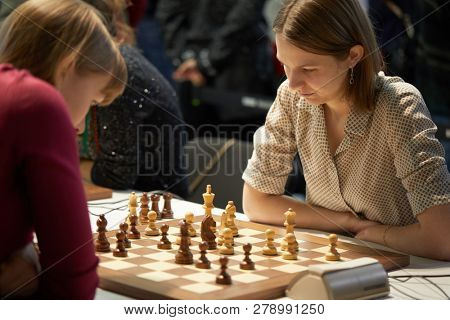 ST. PETERSBURG, RUSSIA - DECEMBER 27, 2018: Grandmaster Anna Muzychuk, Ukraine (right) competes in King Salman World Rapid Chess Championship 2018. Eventually she took 4th place