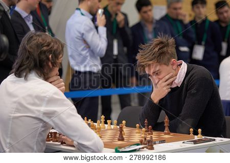 ST. PETERSBURG, RUSSIA - DECEMBER 27, 2018: Grandmaster Daniil Dubov, Russia (right) competes in World Rapid Chess Championship 2018. Eventually he won the tournament and became World Rapid Champion