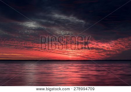 Breathtaking Sunset By The Sea. Red And Blue Clouds. The Sun Has Gone Down The Horizon. Heavenly Ext