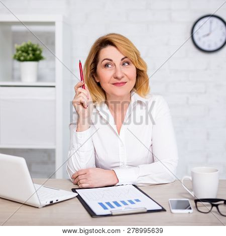 Business Idea Concept - Happy Mature Business Woman With Business Idea Sitting In Modern Office