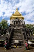 Low angle and front view of the beautiful Chedi of the Wat Chiang Man in Chiang Mai, Thailand poster