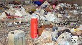 homeless shelter with many garbage and a red broke abandoned extinguisher poster