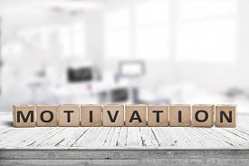 Motivation Sign On A Desk In A Bright Office In A Business Environment