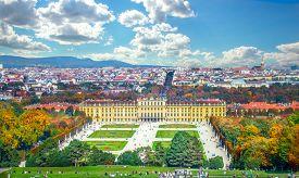 Vienna/ Austria - October 10 2014: Autumn view at Schonbrunn Palace (Schloss Schoenbrunn), imperial summer residence and Great Parterre garden.