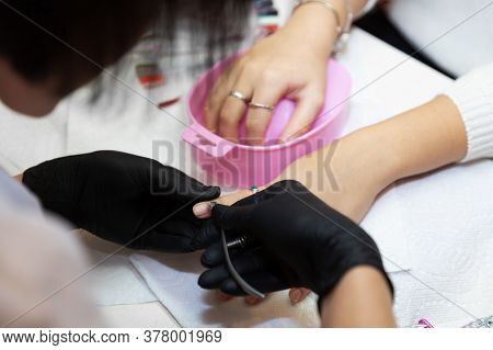 Careful Removing Of Cuticle. Nail Care After Quarantine. Work Of A Manicurist In Salon. Removing The