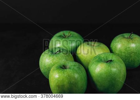 Group Of Organic Green Apples On A Dark Background With Place For Text. Organic Eco Food. Healthy Di