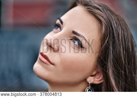Girl Of Brunette  On A Walk In A Cloudy Summer Evening.  Close-up Of The Girl's Face.