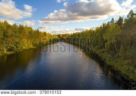 Narrow Forest Lake On A Sunny September Evening. Nature Of The Kostroma Region, Russia