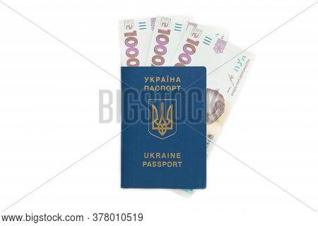 Ukrainian Passport And Money. Biometric Passport Of A Citizen Of Ukraine And 1000 Banknote. Top View
