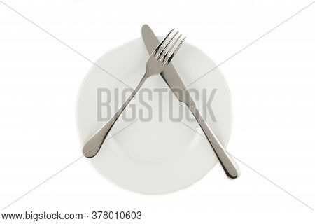 Dining Etiquette - I Still Eat, Pause. Fork And Knife Signals With Location Of Cutlery Set. Photo Il