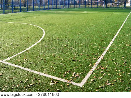Green Artificial Turf Football Field In The Park. White Markings.