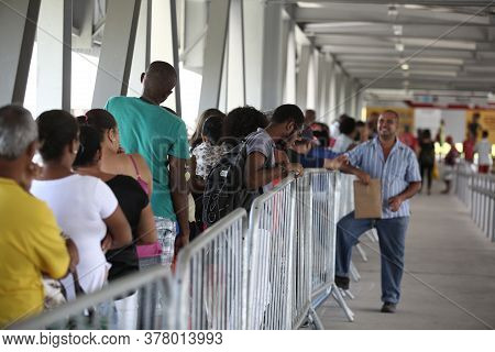 Salvador, Bahia / Brazil - September 11, 2018: Voters Are Seen In Line At The Electoral Regional Tri