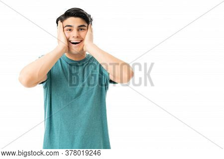 Astonished Handsome Young Man With Mouth Wide Open Standing Over White Background