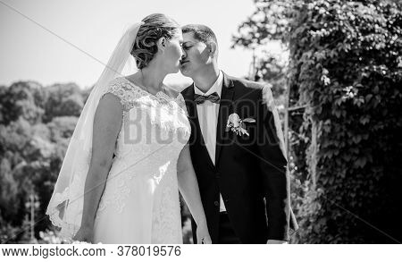 Happy Bride And Groom After Wedding Ceremony .groom Is Younger Than The Bride. Wedding Couple, Newly