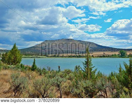 High Desert Water - A View Looking South Across Haystack Reservoir With Haystack Butte In The Backgr