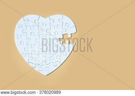Unfinished White Jigsaw Puzzle Pieces On Yellow Background, The Last Piece Of Jigsaw Puzzle, Copy Sp