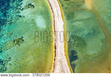 Beautiful Turquoise Sea Surface With Natural Bridge On Dugi Otok Island In Croatia, Drone Aerial Ove
