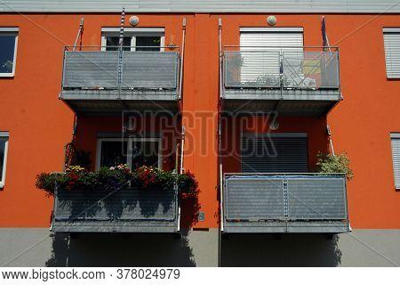 Housing Estate In The City, Orange Apartment Block And Balconies