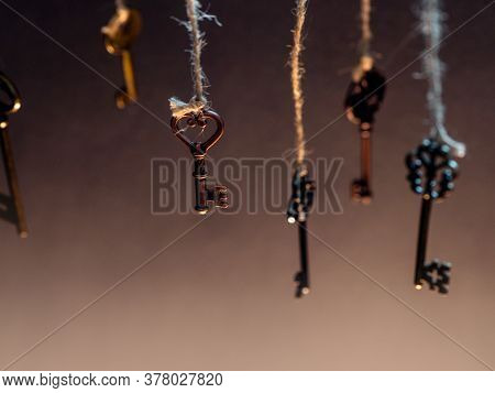 A Lot Of Different Old Keys From Different Locks, Hanging From The Top On Strings. Finding The Right
