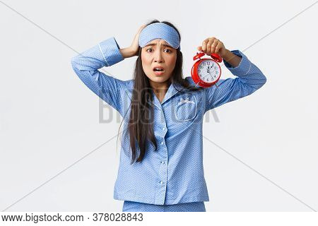 Woman Having Panic As Showing Alarm, Being Late For Work, Overslept To Morning Exam, Holding Hand On