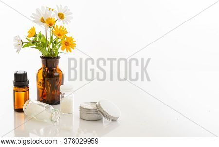 Wild Flowers And Herbal Medicine Products Isolated On White Background.