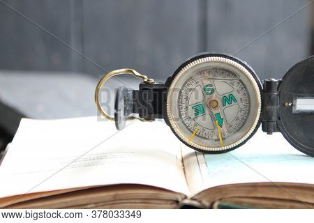 Magnetic Compass On World Map. Adventure, Discovery Concept