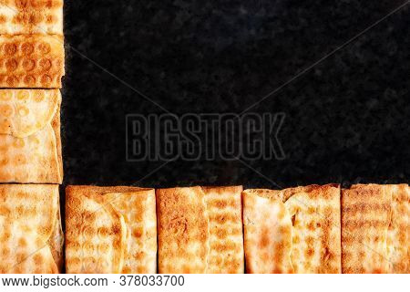 Top View Frame Of Crispy Cookies Stacked On Black Marble. Freshly Baked Cookies. Selective Soft Focu