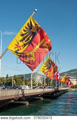 Flags Of Switzerland And The City Of Geneva On A Bridge In Geneva - City Of Geneva, Switzerland - Ju