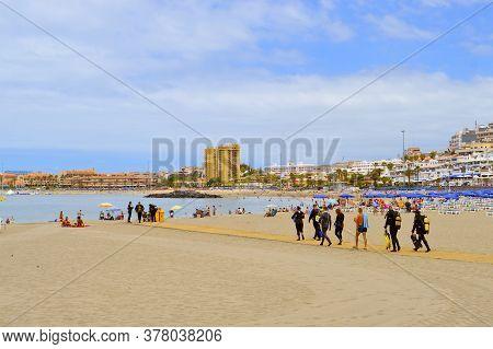Los Cristianos Beach, Tenerife, Canary Islands, Spain, Europe - June 13, 2016: Scuba Divers On The B