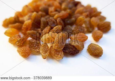 A Low Angle Shot Of Raisins Seedless Kishmish On White Background