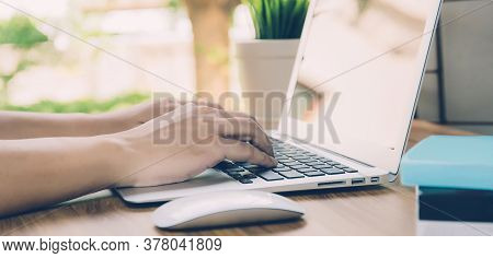 Hand Of Business Man Working From Home Using Laptop Computer On Desk, Lifestyle Of New Normal, Socia