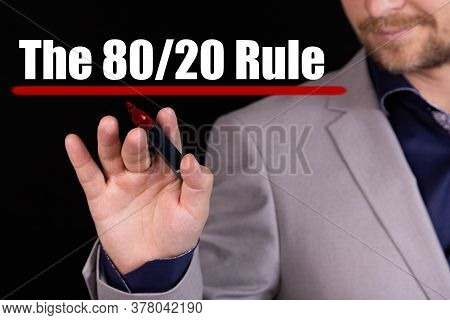 Businessman, Man Writes Marker Text On The Word The 80 On 20 Rule, Pareto Principle. Business Concep