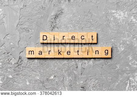 Direct Marketing Word Written On Wood Block. Direct Marketing Text On Cement Table For Your Desing,