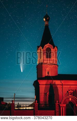 Korma Village, Dobrush District, Belarus. Comet Neowise C2020f3 In Night Starry Sky And St. John The