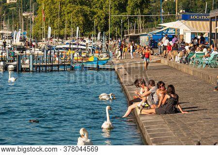 Sunbathing At Lake Geneva In Switzerland - City Of Geneva, Switzerland - July 8, 2020